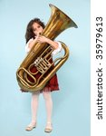 A Girl Playing Tuba Isolated...
