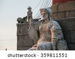 Small photo of The figure at the foot of the northern Rostral column in the center of St. Petersburg allegorically represents the god of the sea and commerce