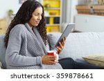woman reading on tablet at home ...   Shutterstock . vector #359878661