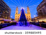 Small photo of BUDAPEST, HUNGARY - DEC 19 2015: Tourists enjoy the Christmas lights at the St Steven Basilica in Budapest, Hungary. This traditional Christmas fair attracts abut 700,000 visitors each year.