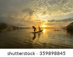 A Fisherman Casting A Net Into...