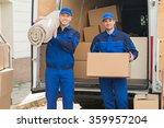 Portrait Of Happy Delivery Men...