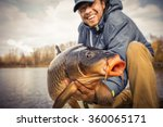 Happy Angler With Carp Fishing...