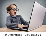 Shocked and surprised boy on the internet with laptop computer concept for amazement, astonishment, making a mistake, stunned and speechless or seeing something he shouldnt see