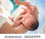 newborn baby first bath | Shutterstock . vector #360365594