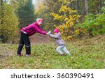 woman with girl doing aerobics... | Shutterstock . vector #360390491