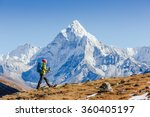 Small photo of Happy hiker walking in the mountains, freedom and happiness, achievement in mountains. Himalayas, Everest Base Camp trek, Nepal