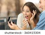 man showing an engagement ring... | Shutterstock . vector #360415304