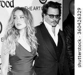 Small photo of Amber Heard and Johnny Depp at the Art Of Elysium's 9th Annual Heaven Gala held at the 3LABS in Culver City, USA on January 9, 2016.