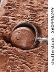 Stock photo chocolate ice cream scooped out from container 360446249