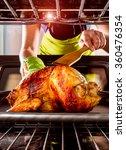 housewife prepares roast... | Shutterstock . vector #360476354
