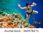 snorkeler diving along the... | Shutterstock . vector #360478271