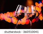 Two Wine Glasses Clink At The...