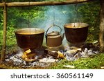 A Group Of Cauldrons And Kettl...
