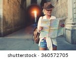 cheerful woman wanderer with... | Shutterstock . vector #360572705