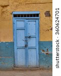 Light Blue Rustic Door Against...