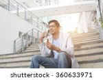 indian male eating a quick... | Shutterstock . vector #360633971