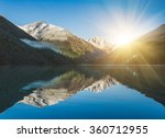 Stock photo beautiful lake in altai mountains sunrise and mountains reflected in the water 360712955