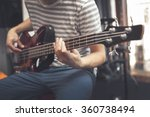 Man Play On Bass Guitar