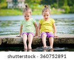 Twin Girls Are Exercising On A...