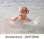 little girl swimming in river | Shutterstock . vector #36075868