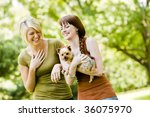 Stock photo young women with dog walking in a park 36075970