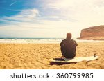 Surfer On The Beach Waiting Fo...