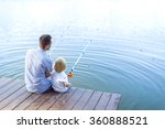 Father And Son Fishing On The...
