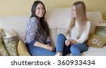 two young woman enjoying a chat | Shutterstock . vector #360933434