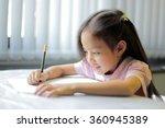 a little girl enjoying her... | Shutterstock . vector #360945389