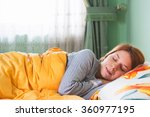 young woman sleeping in bed | Shutterstock . vector #360977195