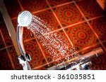 Shower head with water running - stock photo
