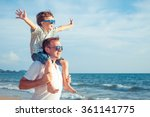 father and son playing on the... | Shutterstock . vector #361141775