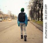 schoolboy alone in the street   Shutterstock . vector #361184189