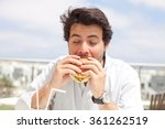 young man eating a hamburger