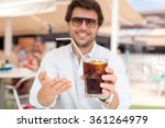 young man drinking a beverage | Shutterstock . vector #361264979
