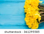 Daffodils On Wooden Background...