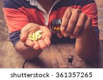 bottle pouring pills on a male...   Shutterstock . vector #361357265