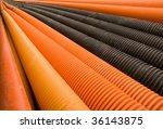 Orange and black plastic pipes - stock photo