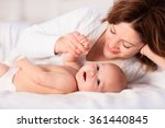 mother and child on a white bed.... | Shutterstock . vector #361440845