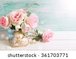 Stock photo pink roses flowers in vase and decorative heart in ray of light on white painted wooden 361703771