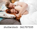 beautiful couple smiling in bed ... | Shutterstock . vector #361707335