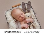 cute baby boy with rabbit toy... | Shutterstock . vector #361718939