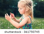 adorable young girl holding... | Shutterstock . vector #361750745