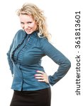Small photo of Portrait of funny middle aged blonde woman. Adult female wearing blue blouse and black skirt having fun in studio.