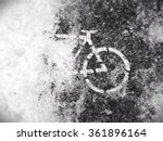 A Bicycle Symbol On A Snowy...