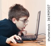 young boy addicted to computer | Shutterstock . vector #361909337