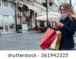 happy woman texting on her... | Shutterstock . vector #361942325
