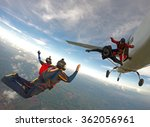 Skydiving Friends Jumping From...