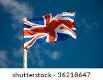 Great Britain Flag Against Blu...